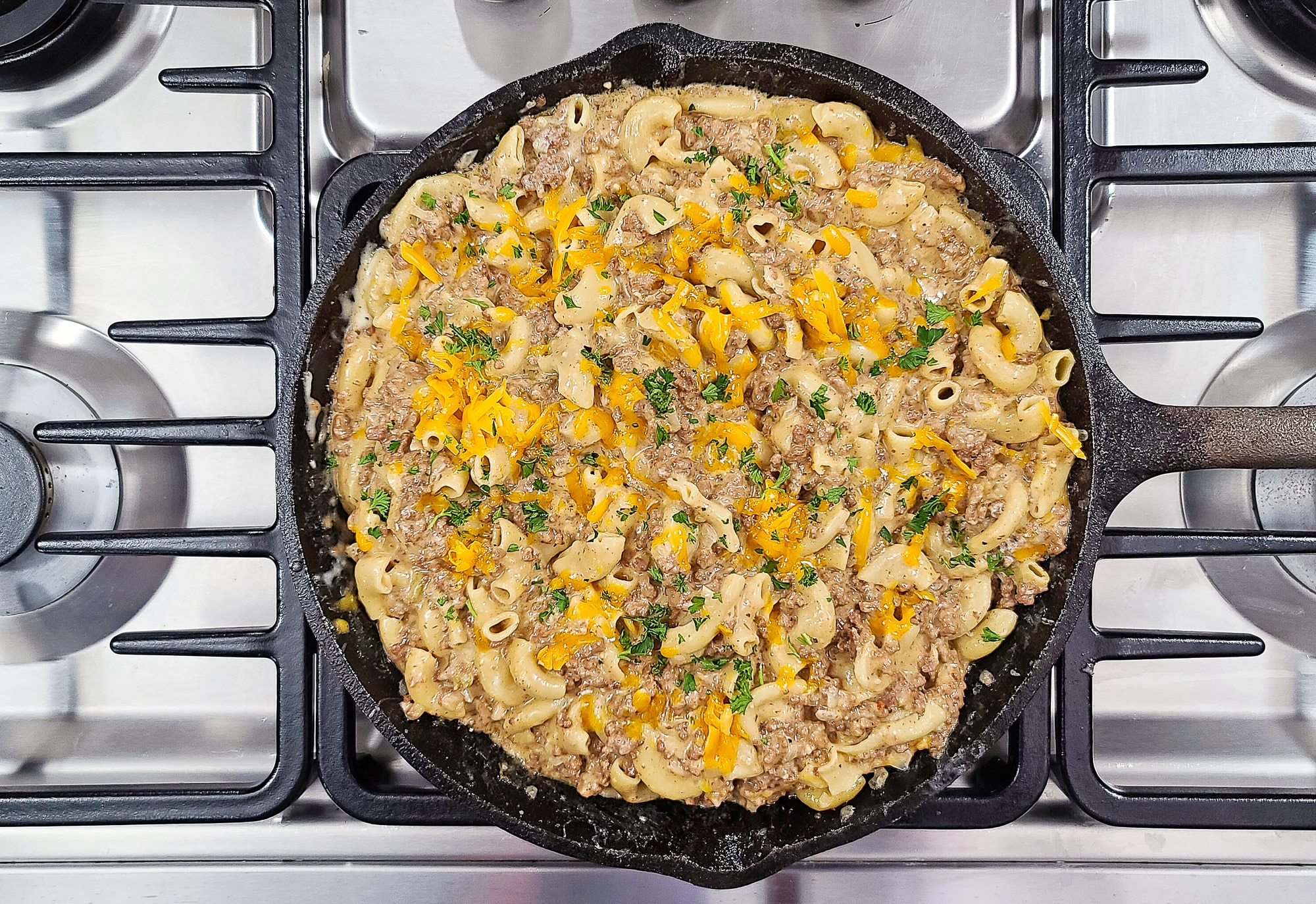 Mac and Cheese Hamburger Helper in cast iron skillet on stovetop