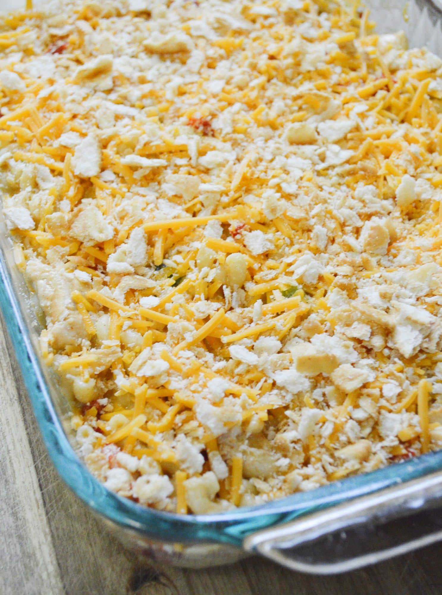 chicken mac n cheese ingredients in glass baking dish
