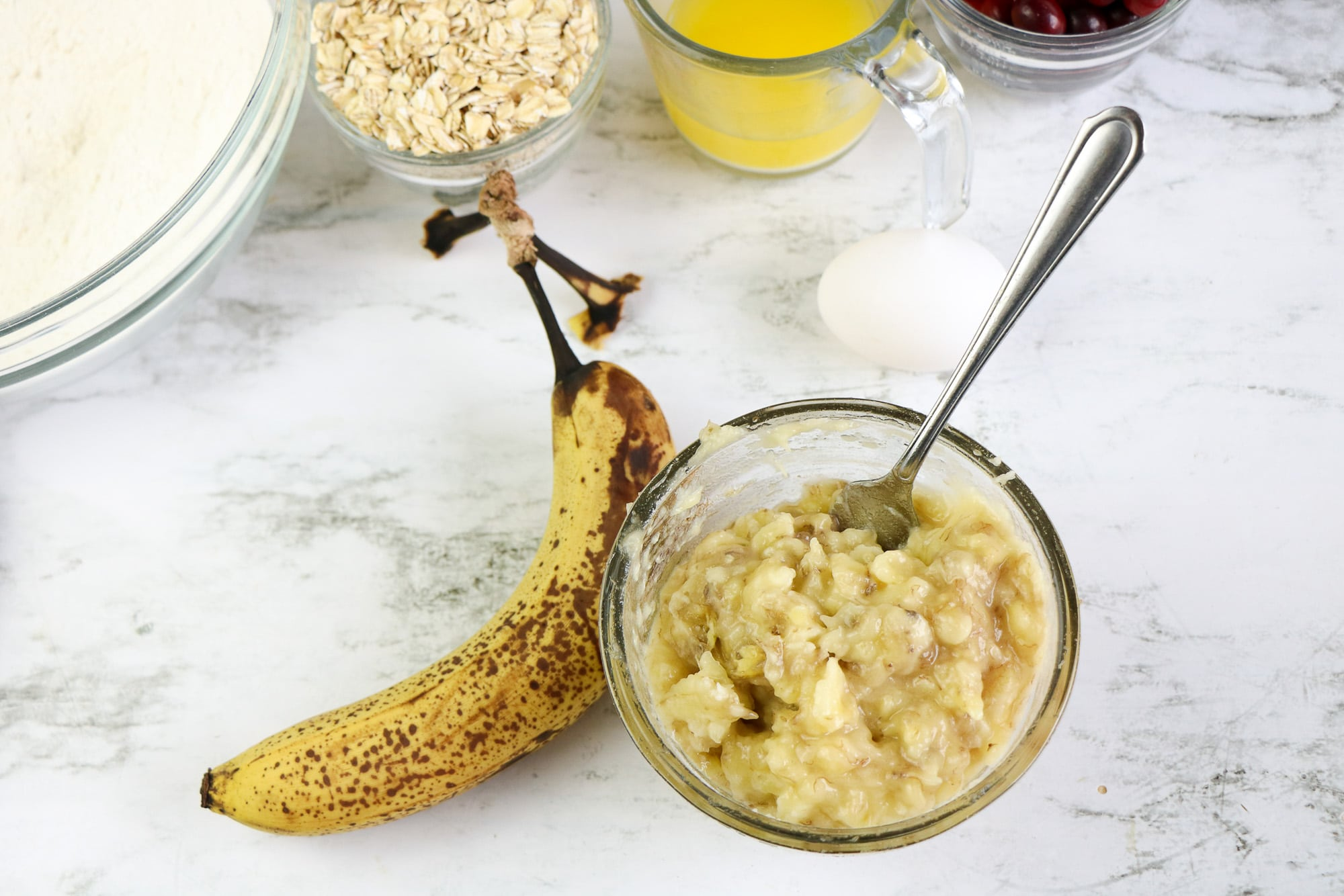 mashed bananas in glass bowl