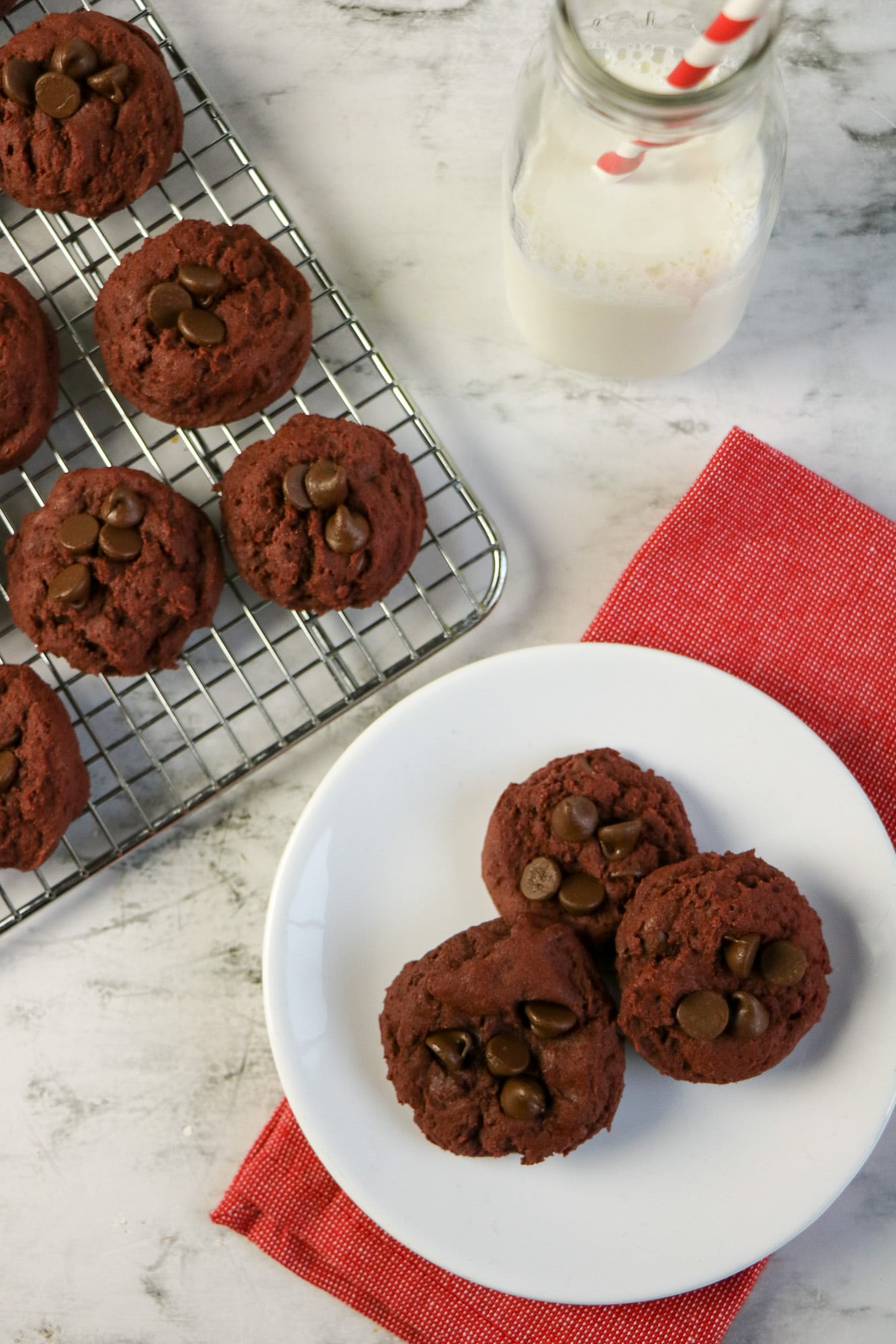 red velvet chocolate chip cookies on white plate