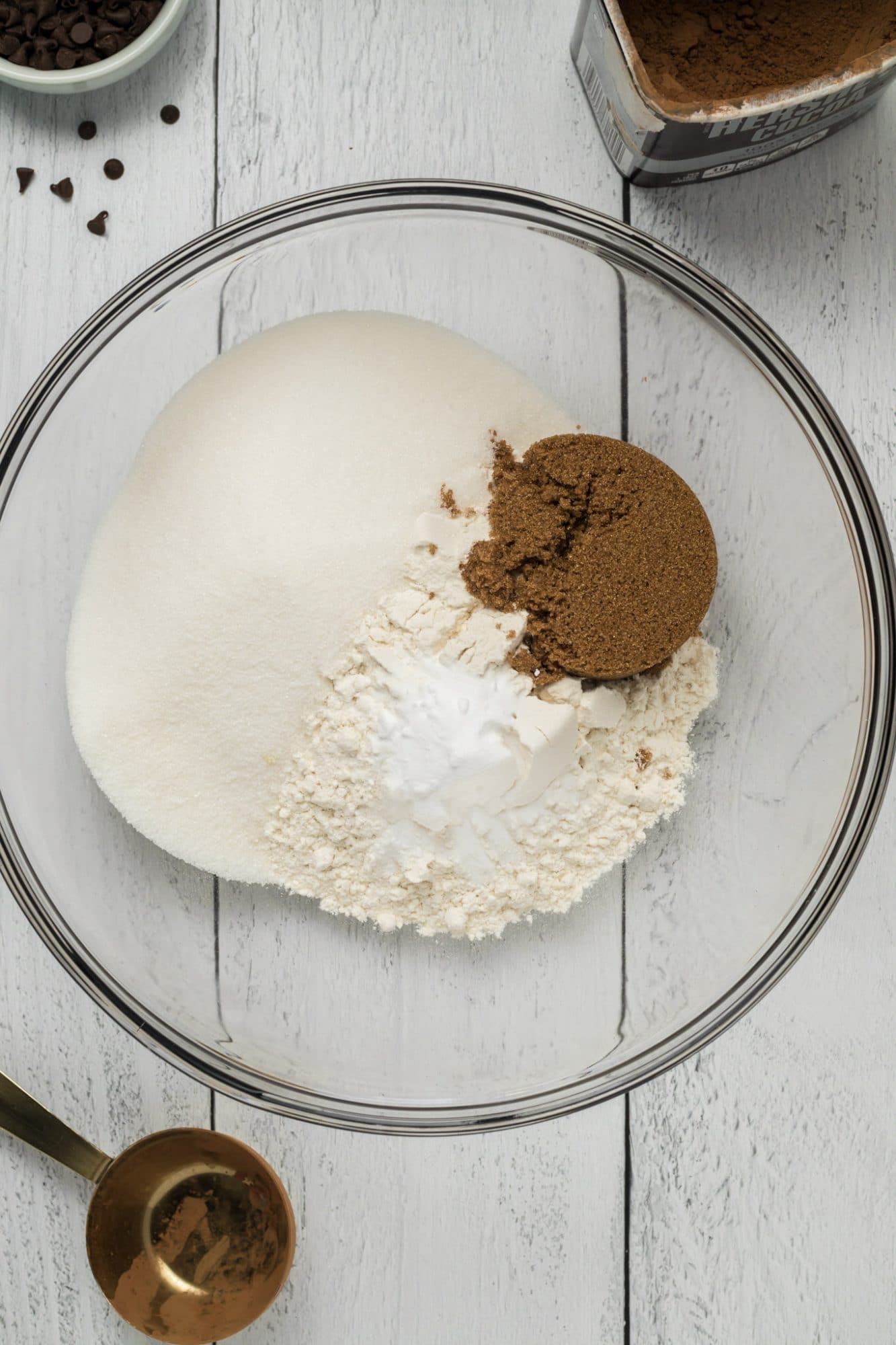 flour, sugar and cocoa powder in clear mixing bowl