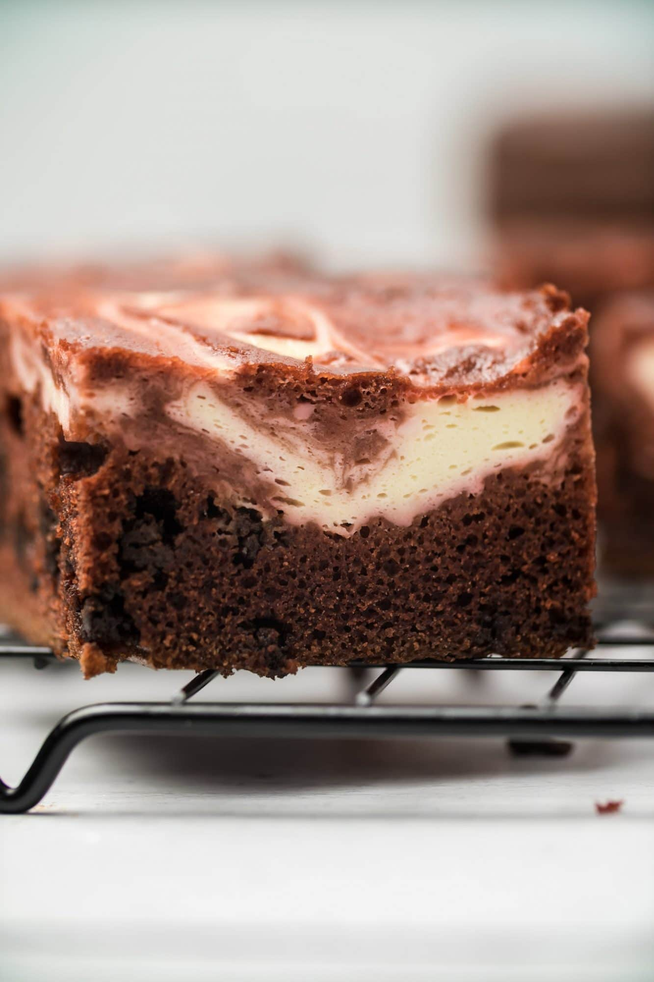 red velvet cheesecake brownies sliced on baking rack