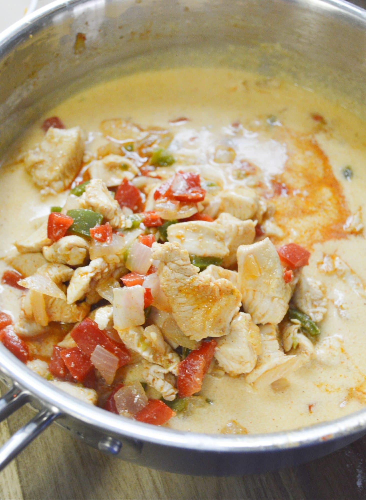 chicken mac n cheese ingredients in skillet