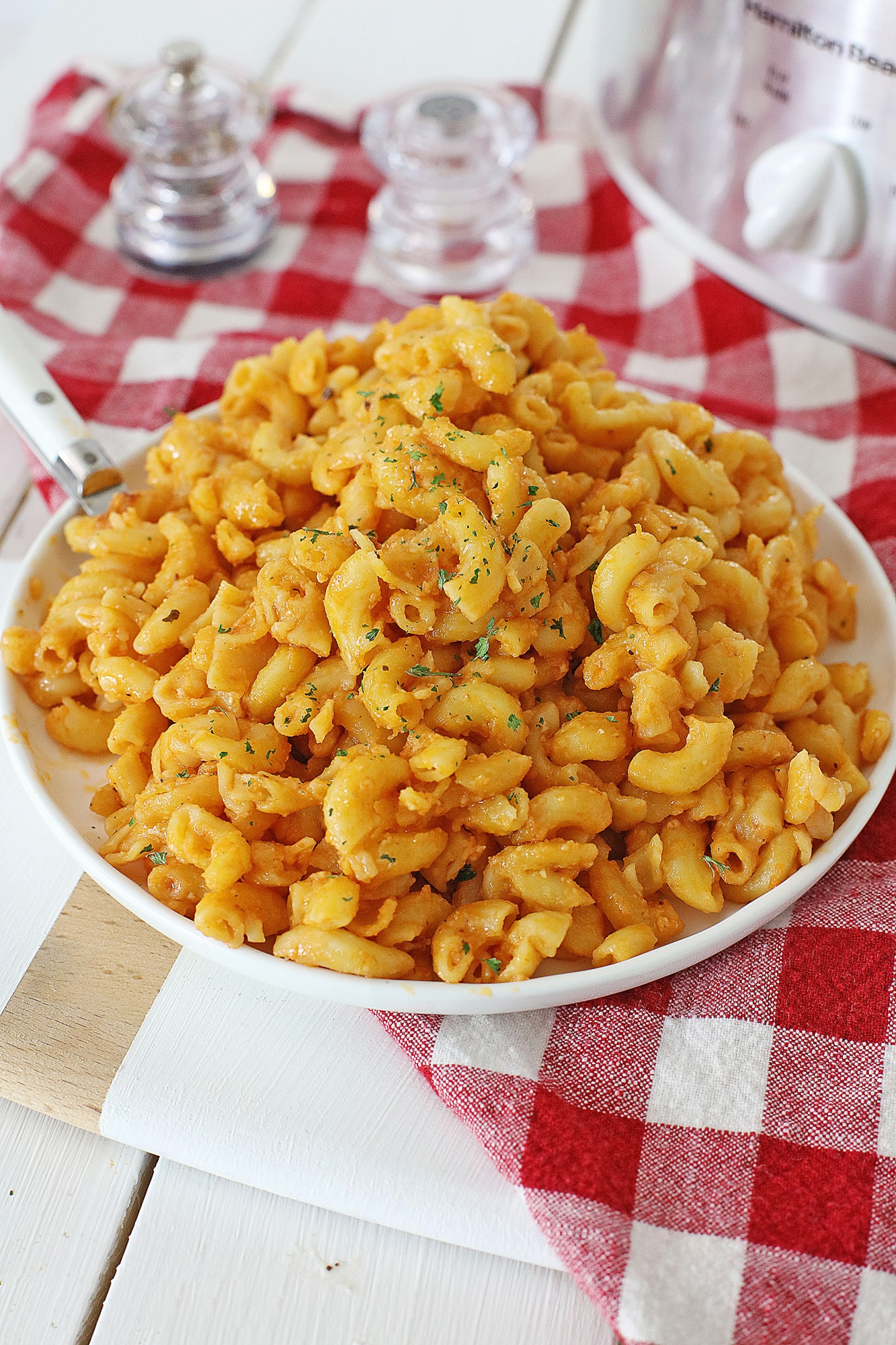 crock pot tomato mac and cheese in white bowl