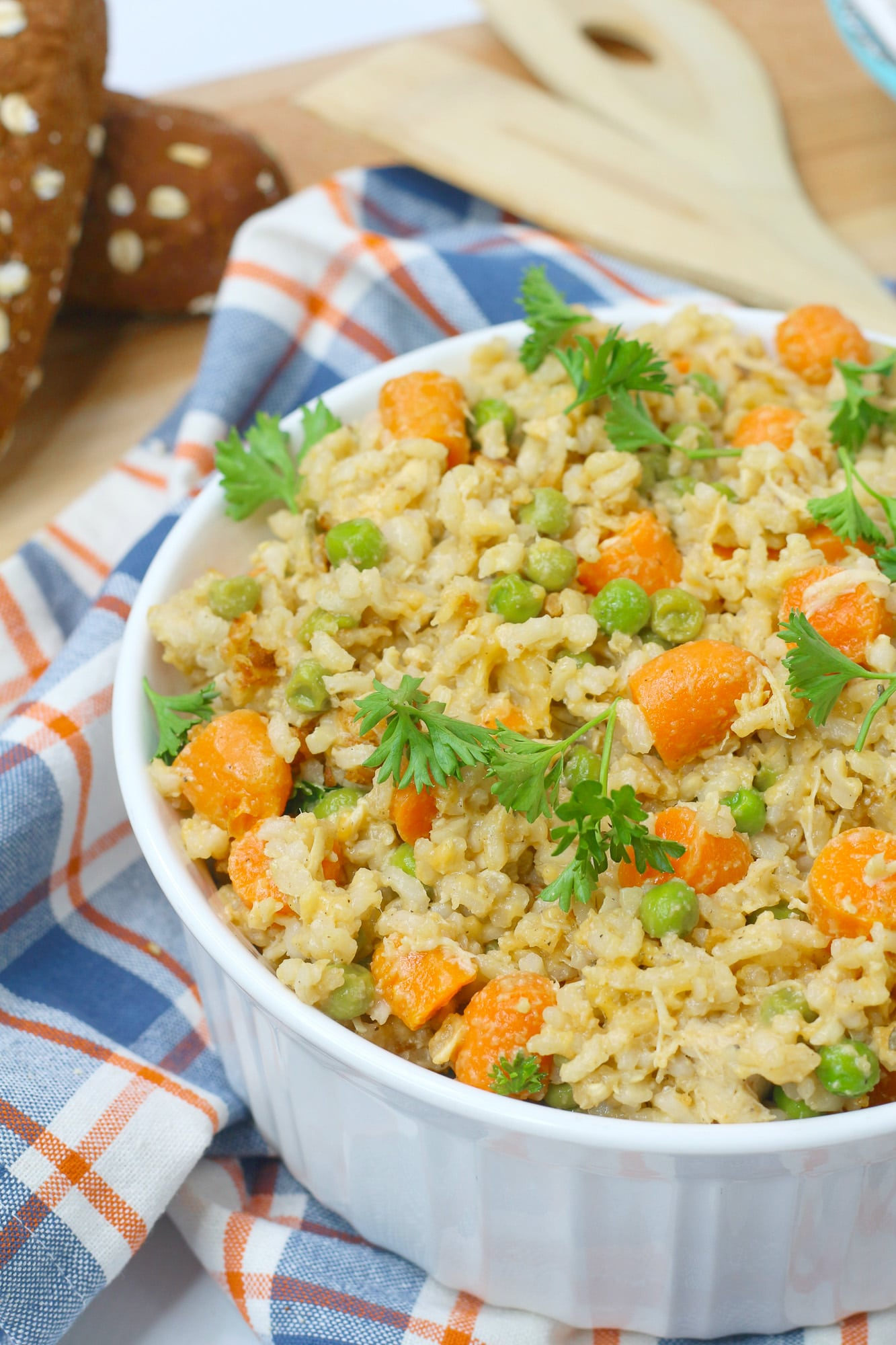 chicken and rice with vegetables in white dish