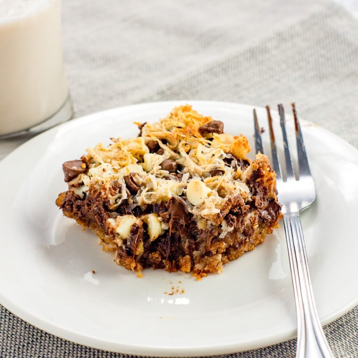magic bars on white plate with fork