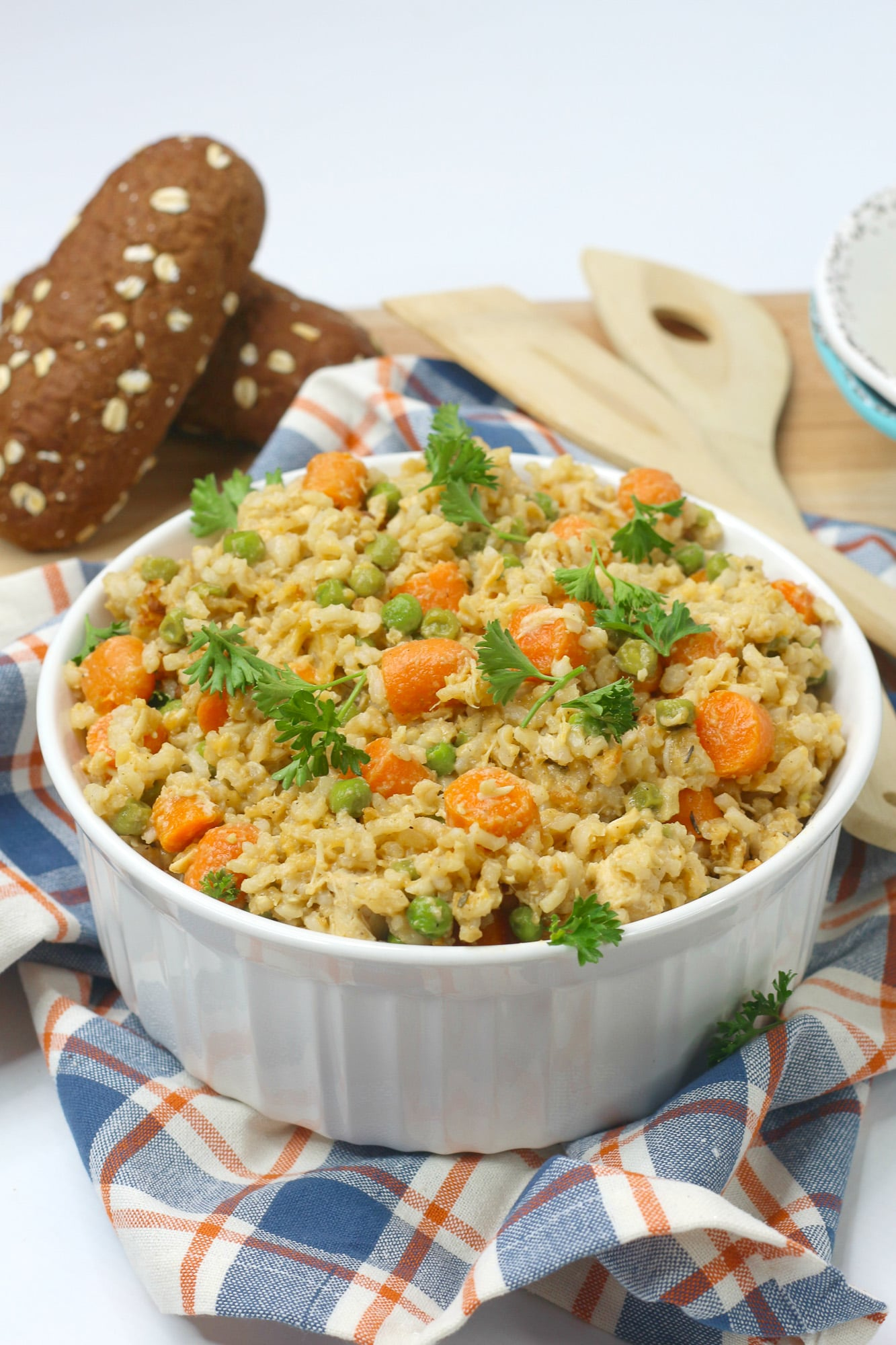 chicken and rice with vegetables in white bowl