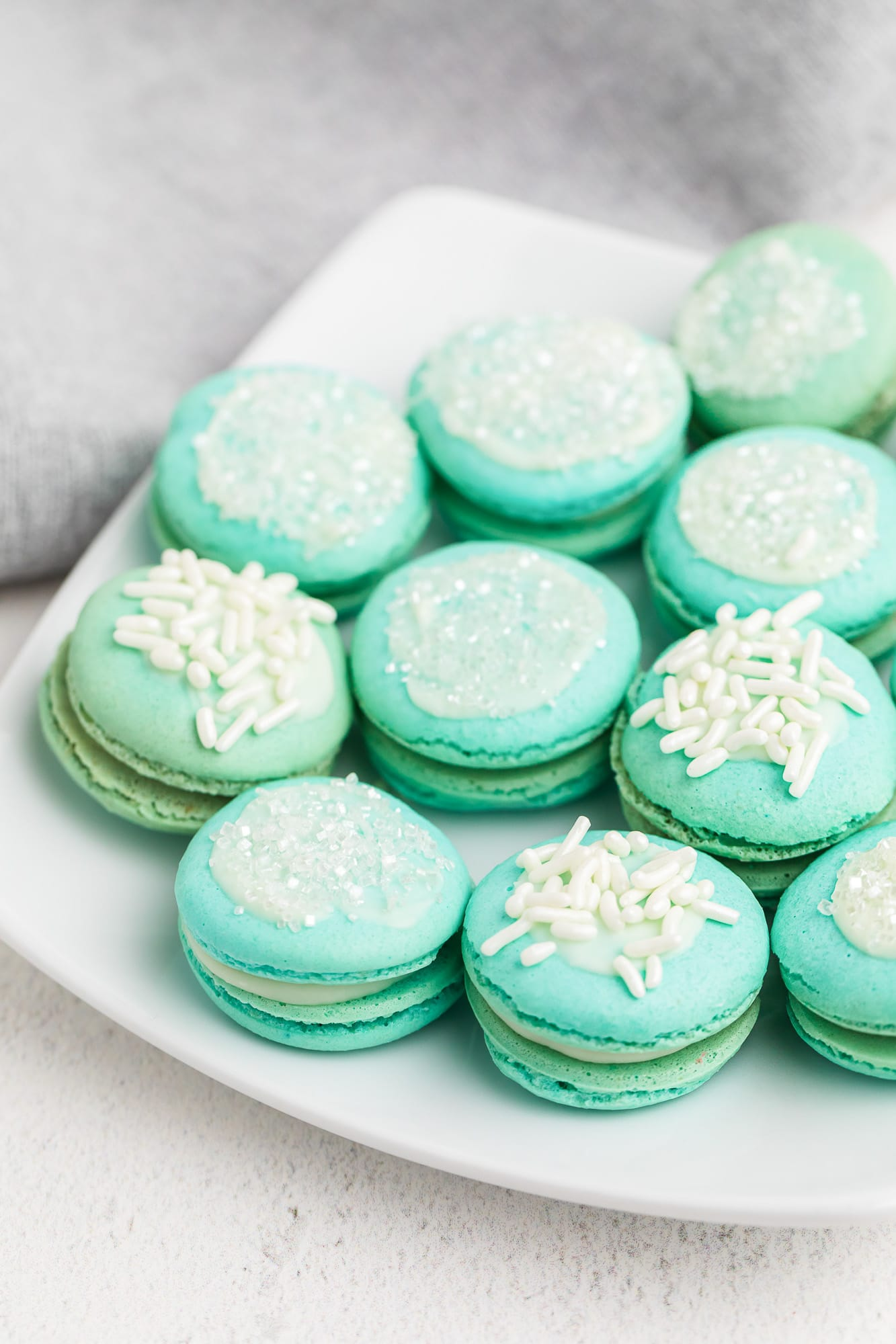 fancy blue macaron cookies on white plate