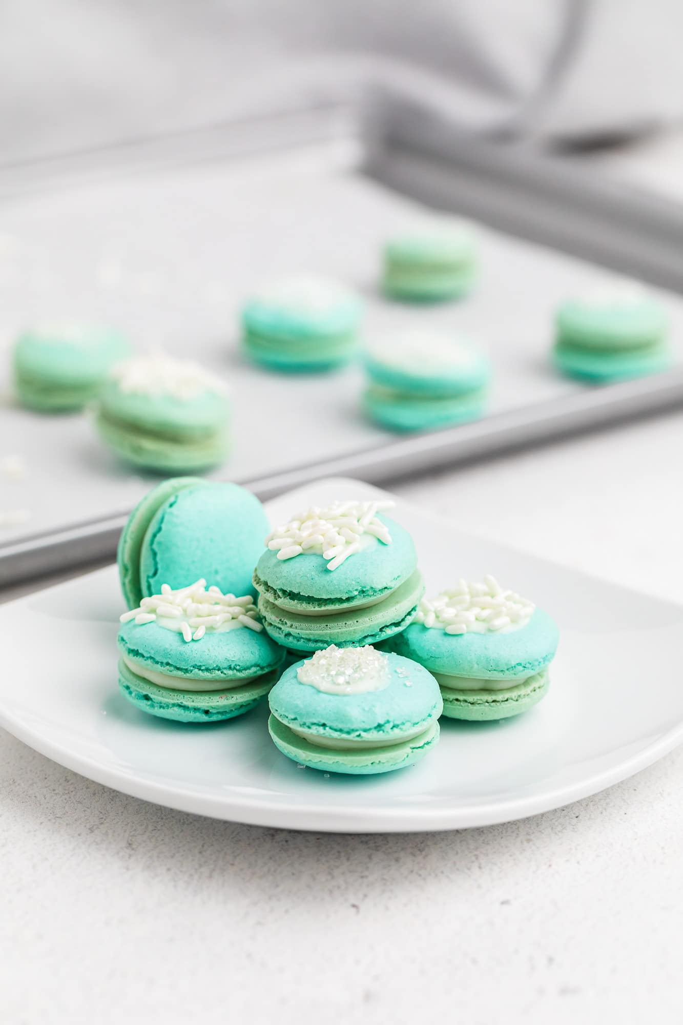 blue macarons on white plate