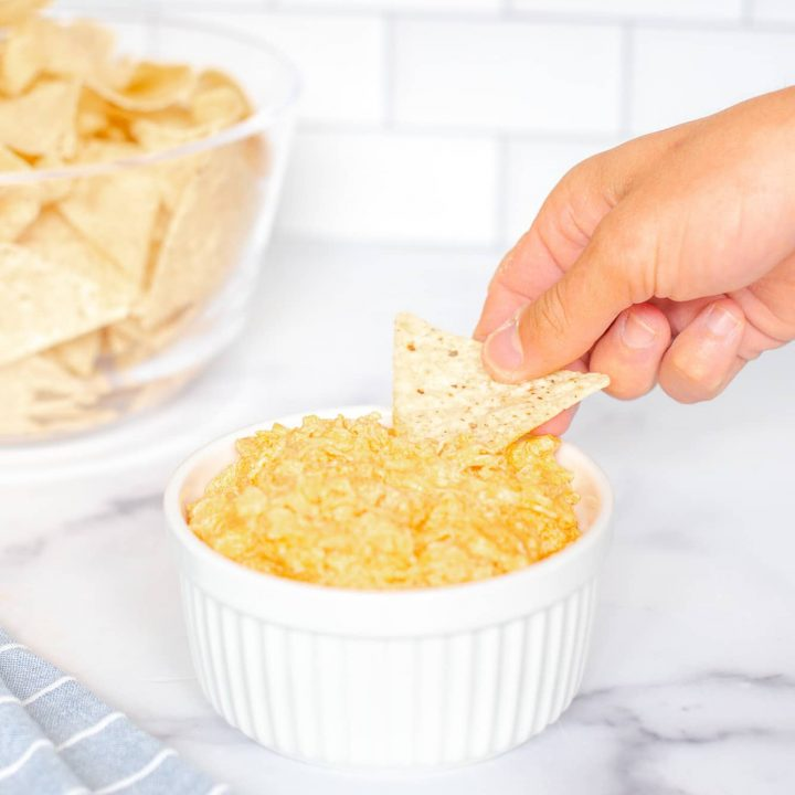 slow cooker buffalo chicken dip in white bowl