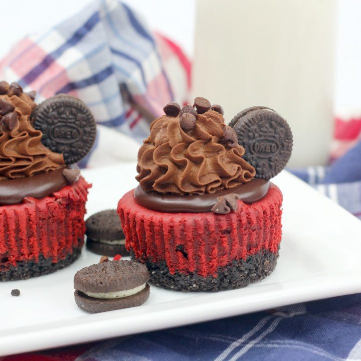 red velvet cheesecakes with oreo crust on a white plate