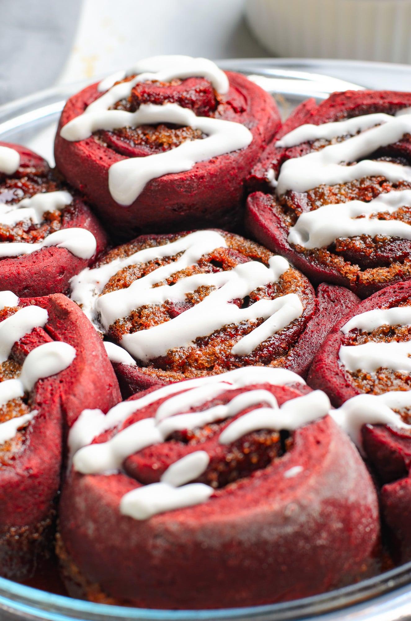 red velvet cinnamon rolls in baking dish