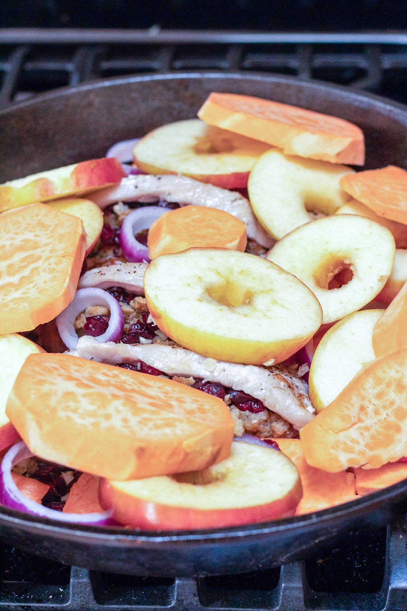 Sliced apples and onions in skillet