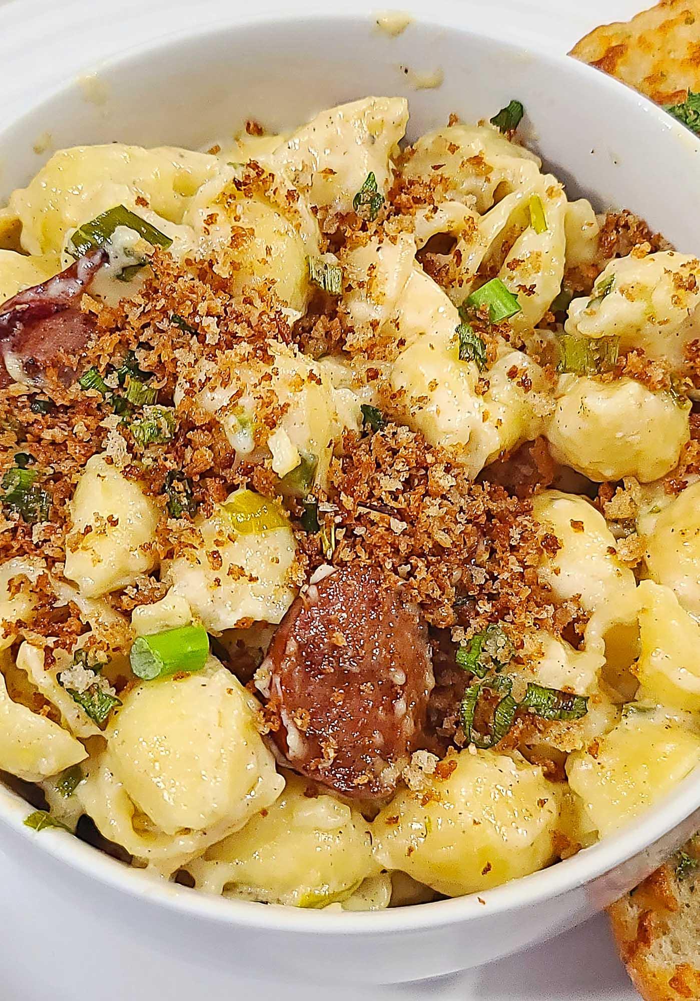 sausage pasta in white bowl