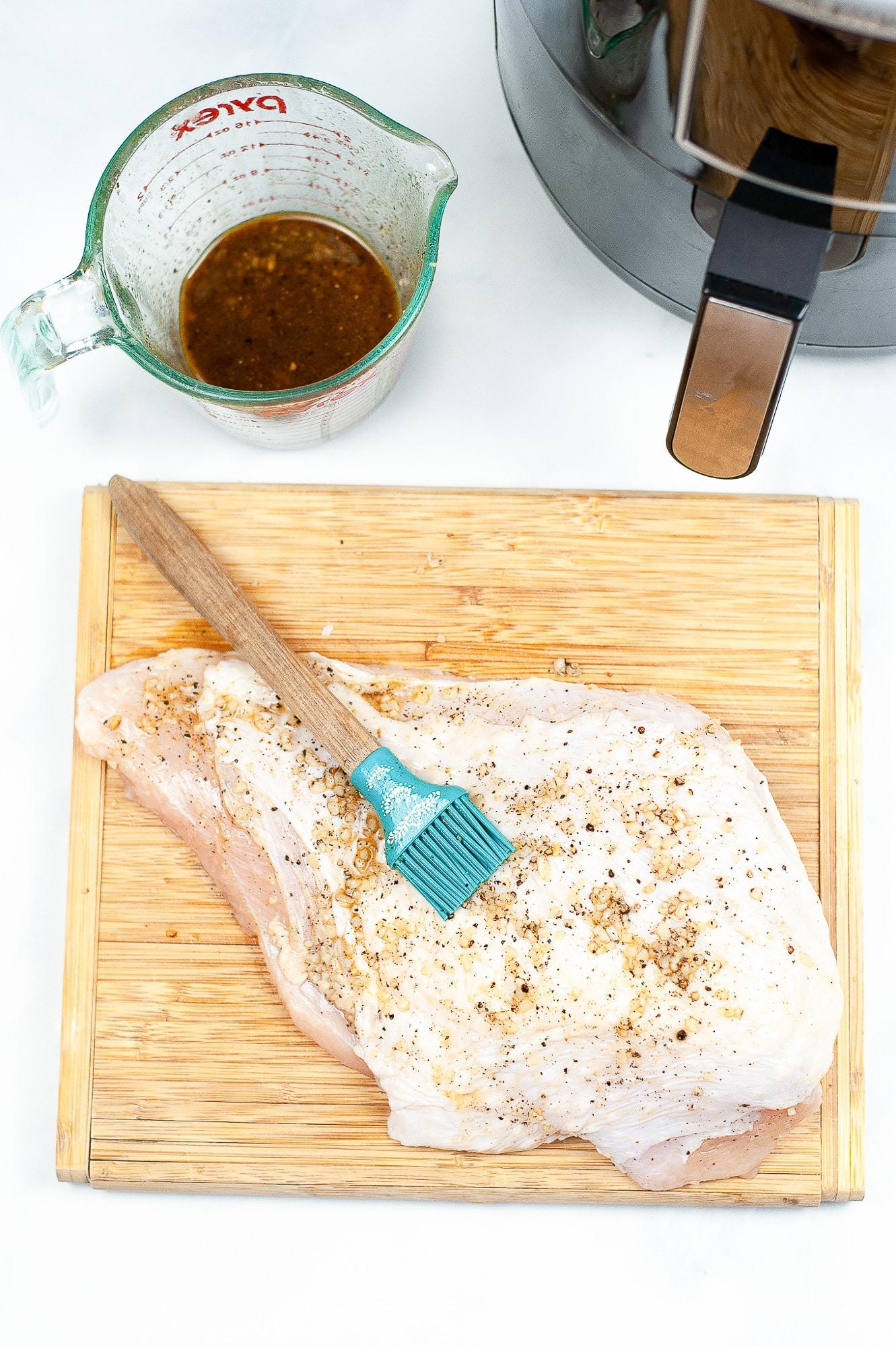 basting brush used to baste seasoning onto turkey breast