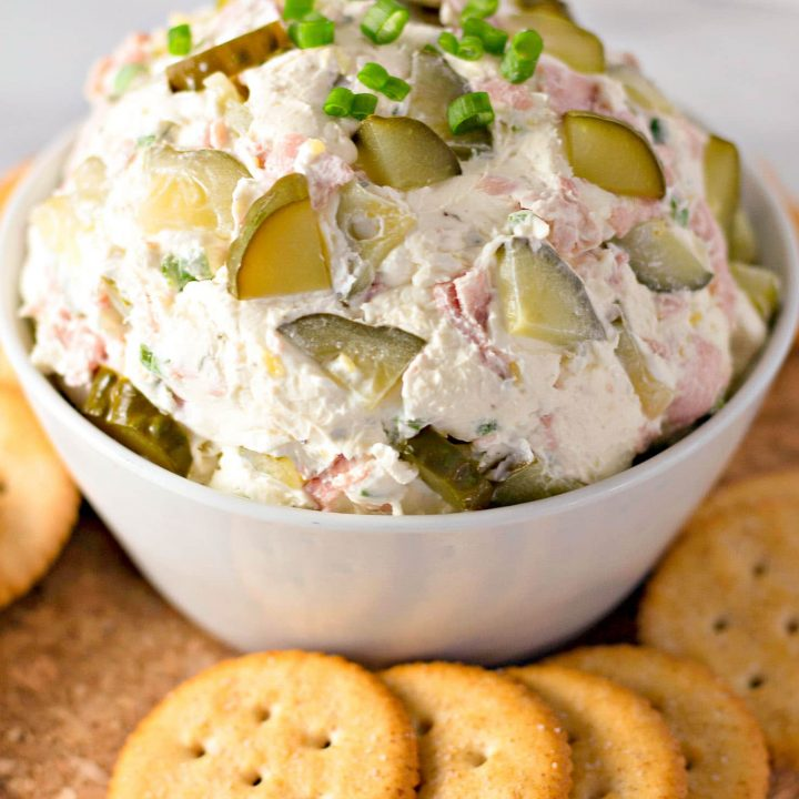 crack pickle dip in bowl with crackers around it