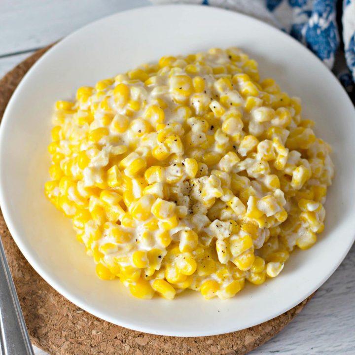 cream corn on a white plate