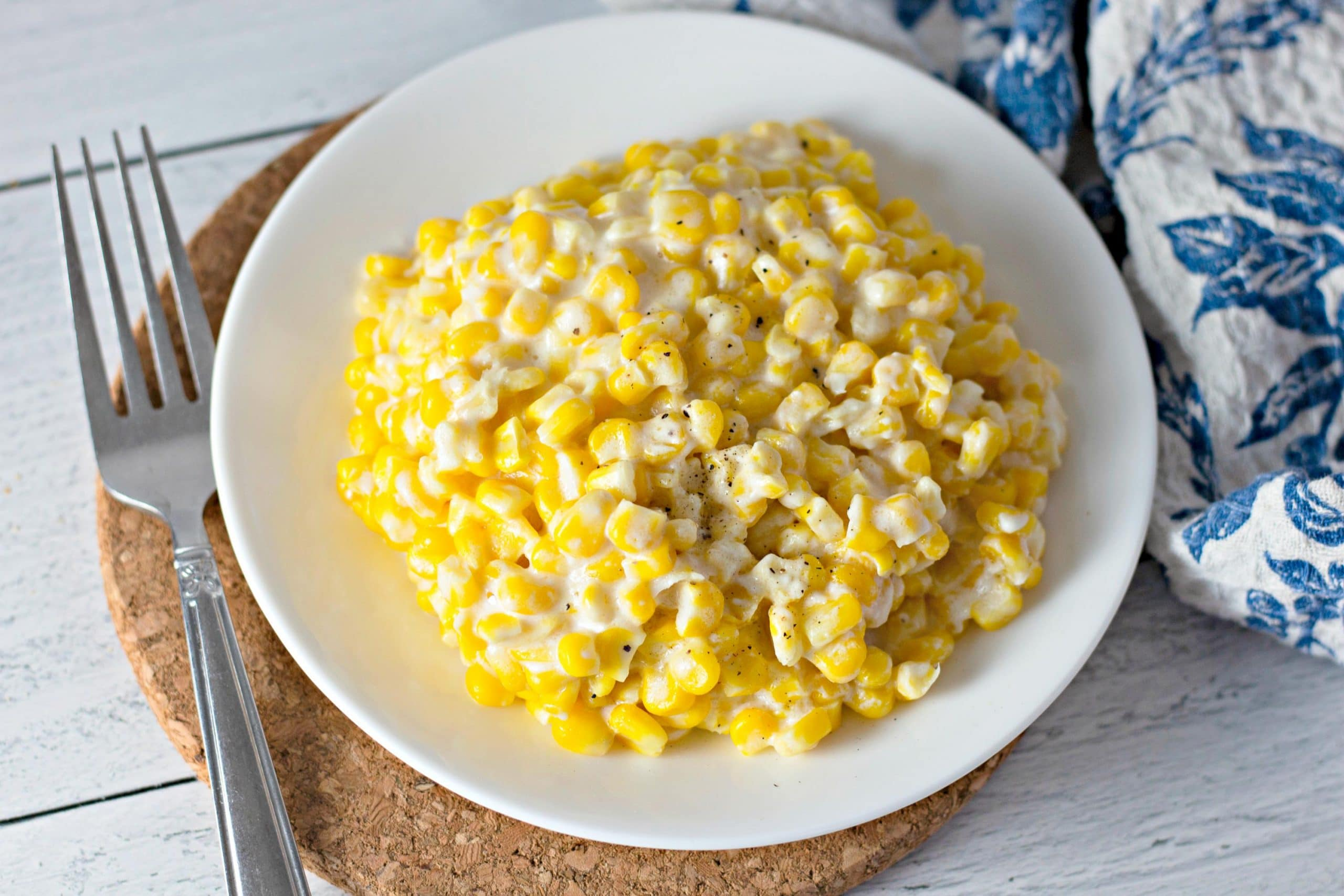 cream corn on a white plate