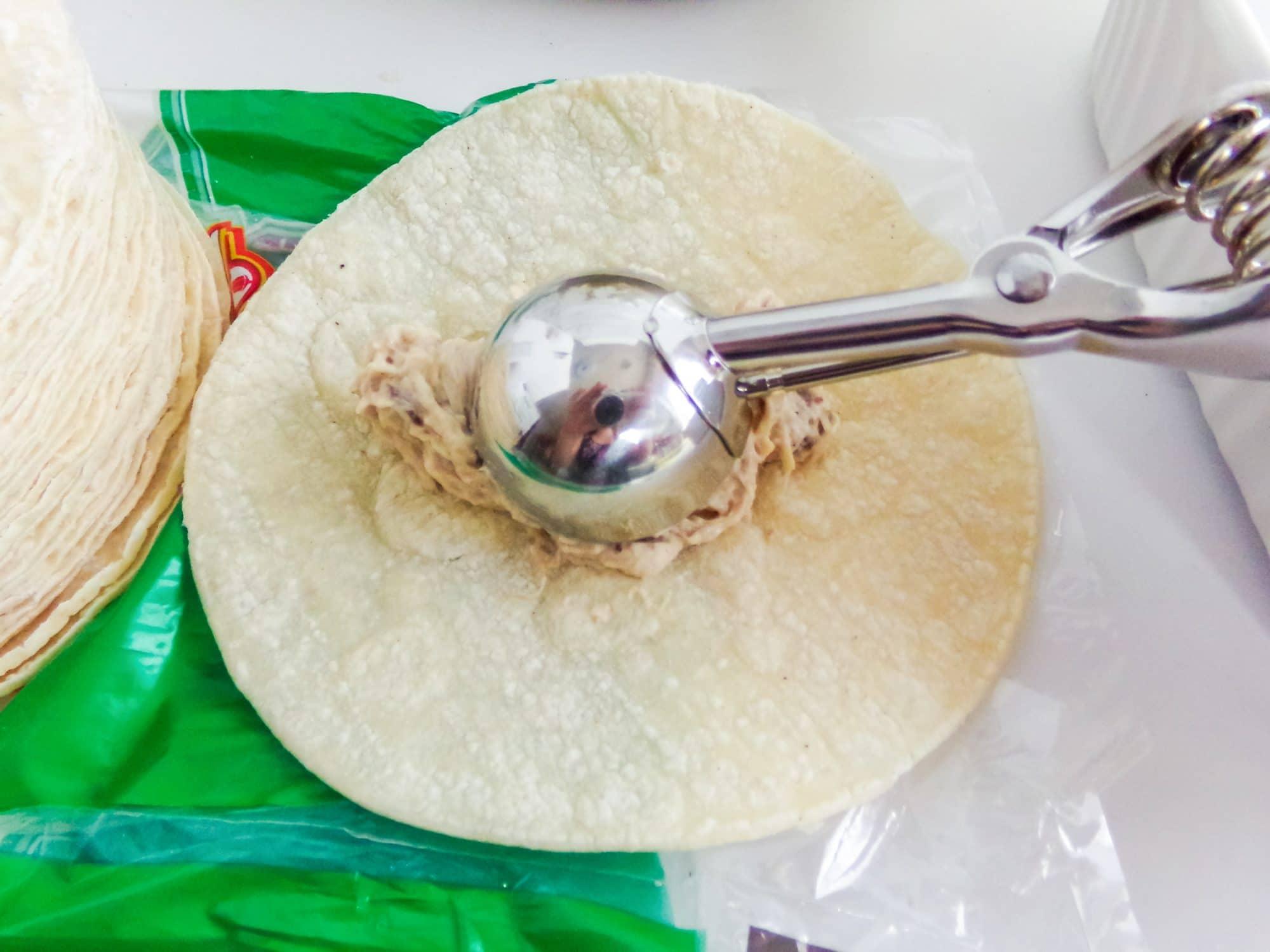 adding chicken to tortilla