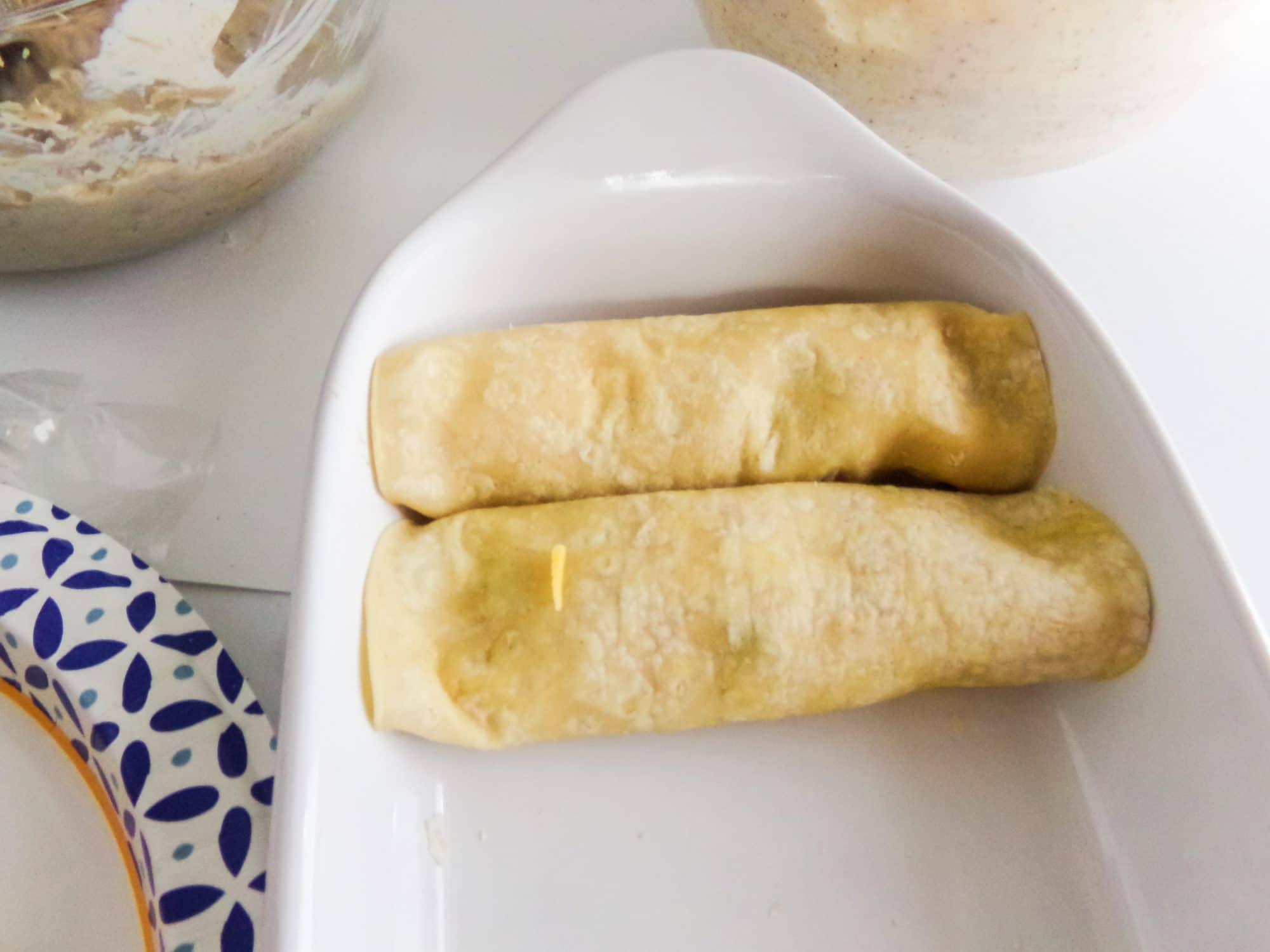 add rolled enchiladas to pan