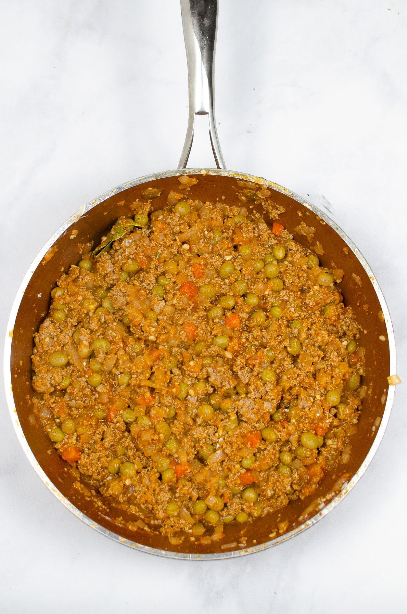 cooked ground meat and onions in pan