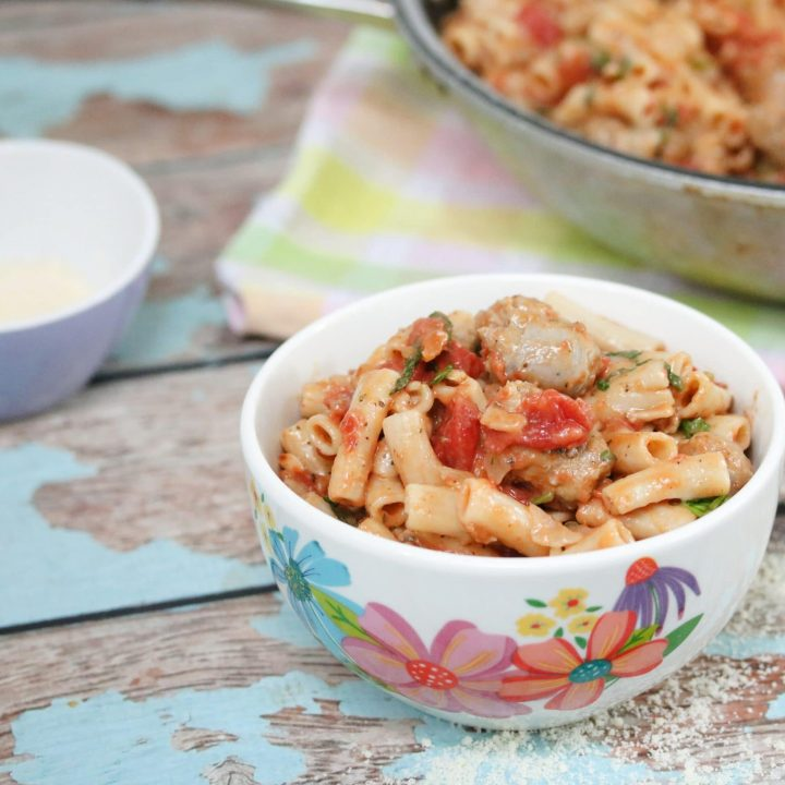 penne pasta with sausage in serving bowl