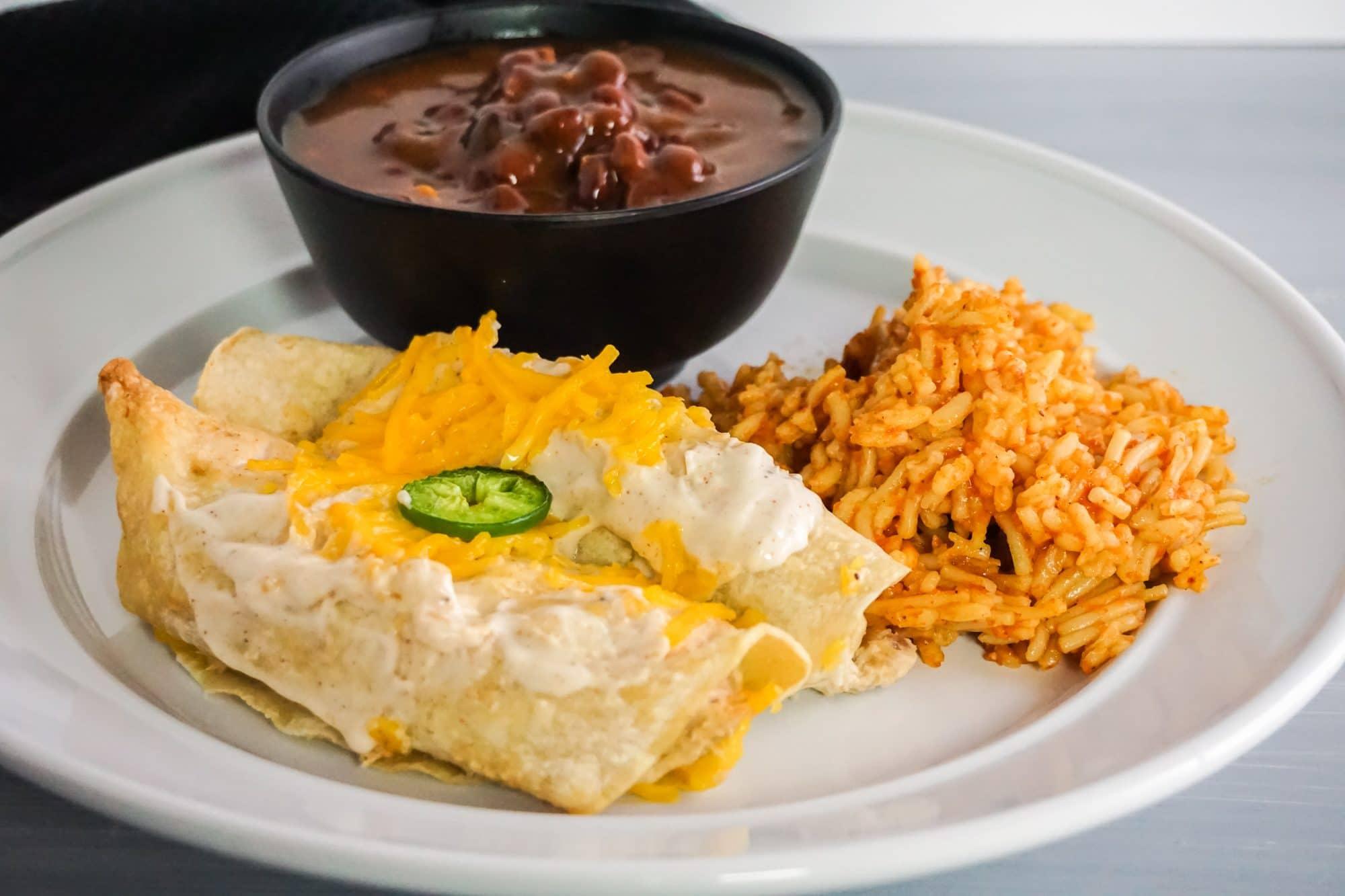 enchilada dinner on white plate