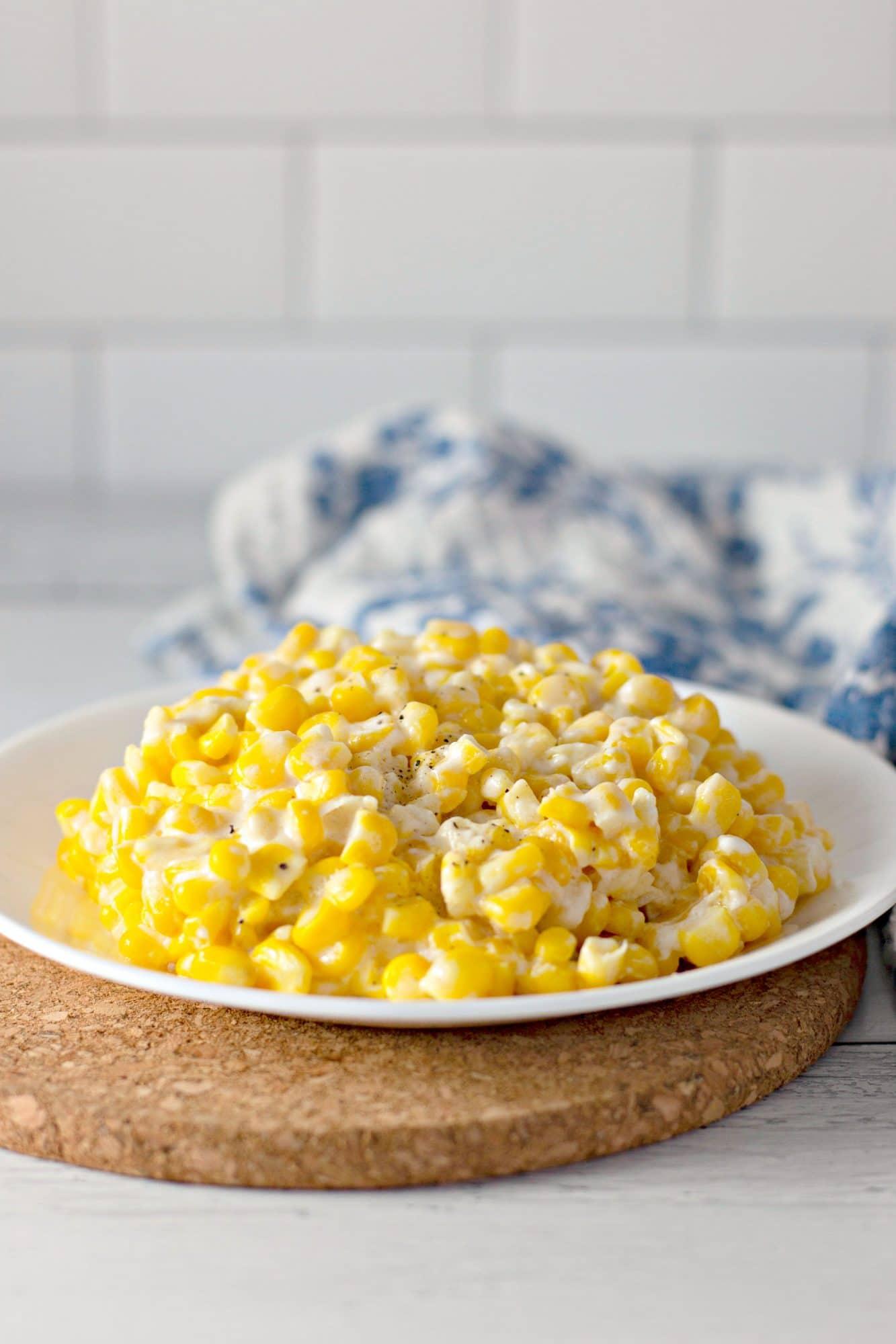 cream corn on white plate