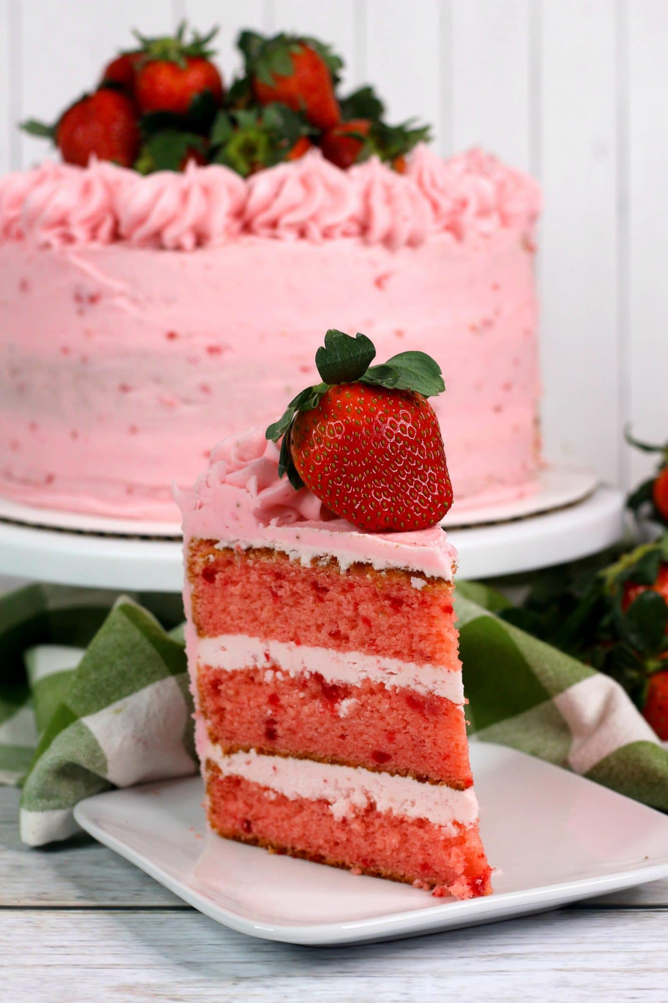 easy strawberry layered cake on white plate