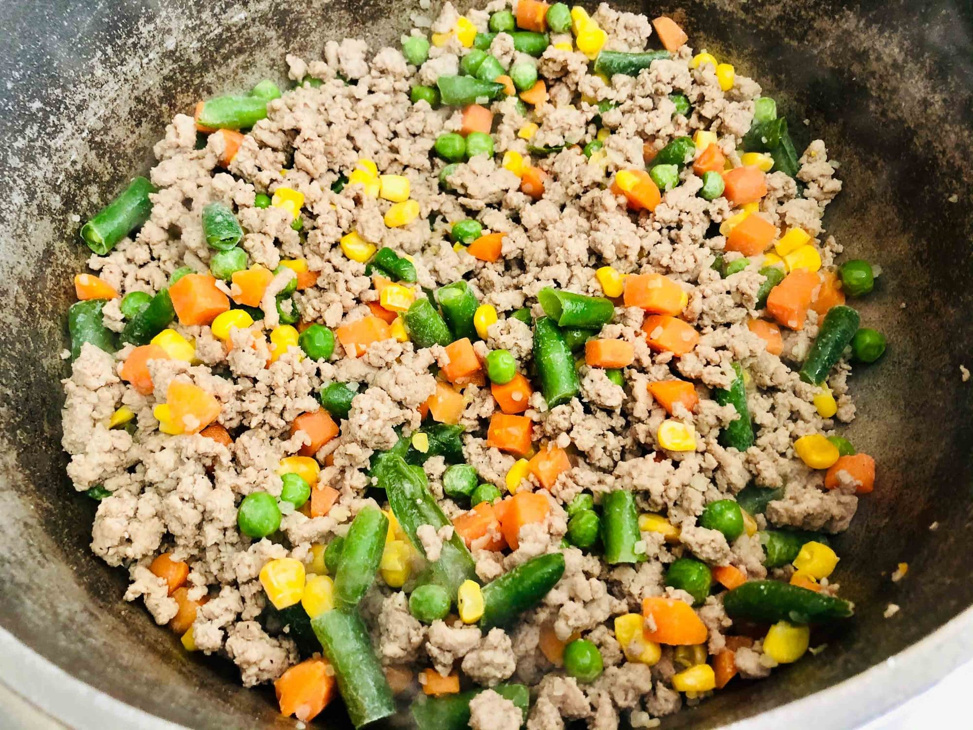 ground beef and vegetables in pan